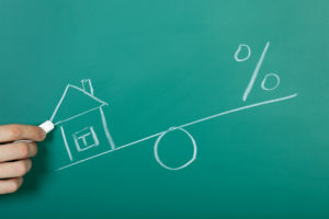 Drawing a mortgage illustration on a chalkboard